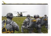 U.s. Army Paratroopers Prepare To Board Carry-all Pouch