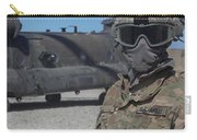 U.s. Army Soldier Stands Ready To Load Carry-all Pouch