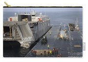 Vehicles Are Transferred Aboard Carry-all Pouch