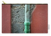 Vertical Drainpipe Against Colorful Carry-all Pouch