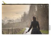Victorian Woman Walking On A Cobbled Avenue At Sunset Carry-all Pouch