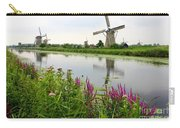 Windmills Of Kinderdijk With Wildflowers Carry-all Pouch by Carol Groenen