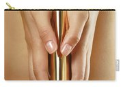 Woman Holding A Gold Vibrator Carry-all Pouch