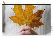 Woman Holding An Autumn Leaf Carry-all Pouch