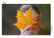 Woman Holding An Autumnal Leaf Carry-all Pouch