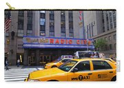 Yellow Cabs Pass In Front Of Radio City Music Hall Carry-all Pouch