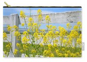 Yellow Flowers And A White Fence Carry-all Pouch