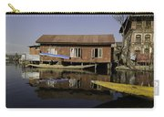 Yellow Shikara In Front Of A Run Down Area Of Houses In The Dal Lake Carry-all Pouch