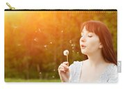 Young Beautiful Woman Blowing A Dandelion In Spring Scenery Carry-all Pouch