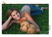 Young Woman And Golden Retriever Puppies Carry-all Pouch