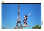 Young Woman Jumping Against Eiffel Tower Carry-all Pouch