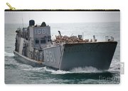 A Landing Craft Utility Transits Carry-all Pouch