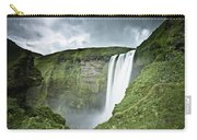 A Waterfall Over A Grassy Cliff Carry-all Pouch