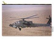 An Ah-64d Apache Longbow Fires A Hydra Carry-all Pouch