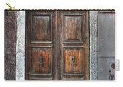 an old wooden door in Italy Carry-all Pouch by Joana Kruse