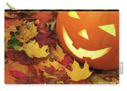 Carved Pumpkin On Fallen Leaves Carry-all Pouch