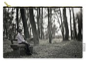 Girl Sitting On A Wooden Bench In The Forest Against The Light Carry-all Pouch by Joana Kruse