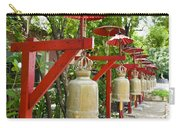 Row Of Bells In A Temple Covered By Red Umbrella Carry-all Pouch
