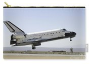 Space Shuttle Atlantis Prepares Carry-all Pouch