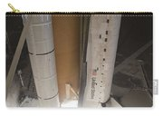 Space Shuttle Discovery Lifts Carry-all Pouch