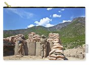 U.s. Army Soldier And An Afghan Carry-all Pouch