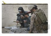 U.s. Marine Watches An Afghan Police Carry-all Pouch