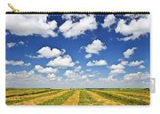 Wheat Farm Field At Harvest In Saskatchewan Carry-all Pouch by Elena Elisseeva