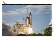Space Shuttle Atlantis Lifts Carry-all Pouch