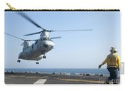 A Ch-46e Sea Knight Helicopter Prepares Carry-all Pouch