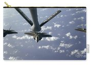 A Three Ship Formation Of F-22 Raptors Carry-all Pouch by Stocktrek Images