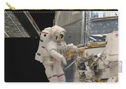 Astronauts Working On The Hubble Space Carry-all Pouch