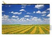 Farm Field At Harvest In Saskatchewan Carry-all Pouch by Elena Elisseeva