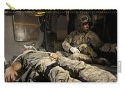 U.s. Army Specialist Practices Giving Carry-all Pouch