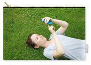 Woman Using Her Iphone Carry-all Pouch by Photo Researchers, Inc.