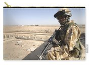 A British Army Soldier Provides Carry-all Pouch by Andrew Chittock