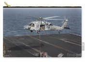 A Mh-60s Knighthawk Conducts A Vertical Carry-all Pouch