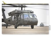A Uh-60 Black Hawk Taxis Carry-all Pouch by Terry Moore