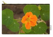 A Beautiful Orange Trumpet Shaped Flower With Green Leaves Carry-all Pouch