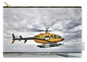 A Bell 407 Utility Helicopter Prepares Carry-all Pouch