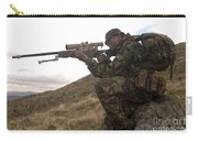 A British Soldier Armed With A Sniper Carry-all Pouch