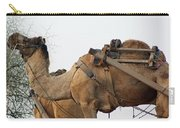 A Camel Foraging For Food In A Desert Environment Carry-all Pouch