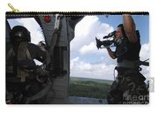 A Cinematographer Videotapes A Soldier Carry-all Pouch