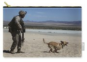A Dog Handler Conducts Improvised Carry-all Pouch by Stocktrek Images