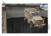 A Harbor Crane Lifts A Mine-resistant Carry-all Pouch