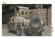 A Humvee Patrols The Streets Of Kunduz Carry-all Pouch