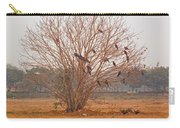 A Leafless Tree That Is Home To A Large Number Of Big Birds In The Middle Of A Ground Carry-all Pouch