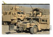 A M1114 Humvee Sits Parked In Front Carry-all Pouch