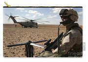 A Marine Assembles A Radio Antenna Carry-all Pouch