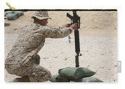 A Marine Hangs Dog Tags On The Rifle Carry-all Pouch