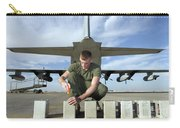 A Marine Replaces Flares In Flare Carry-all Pouch